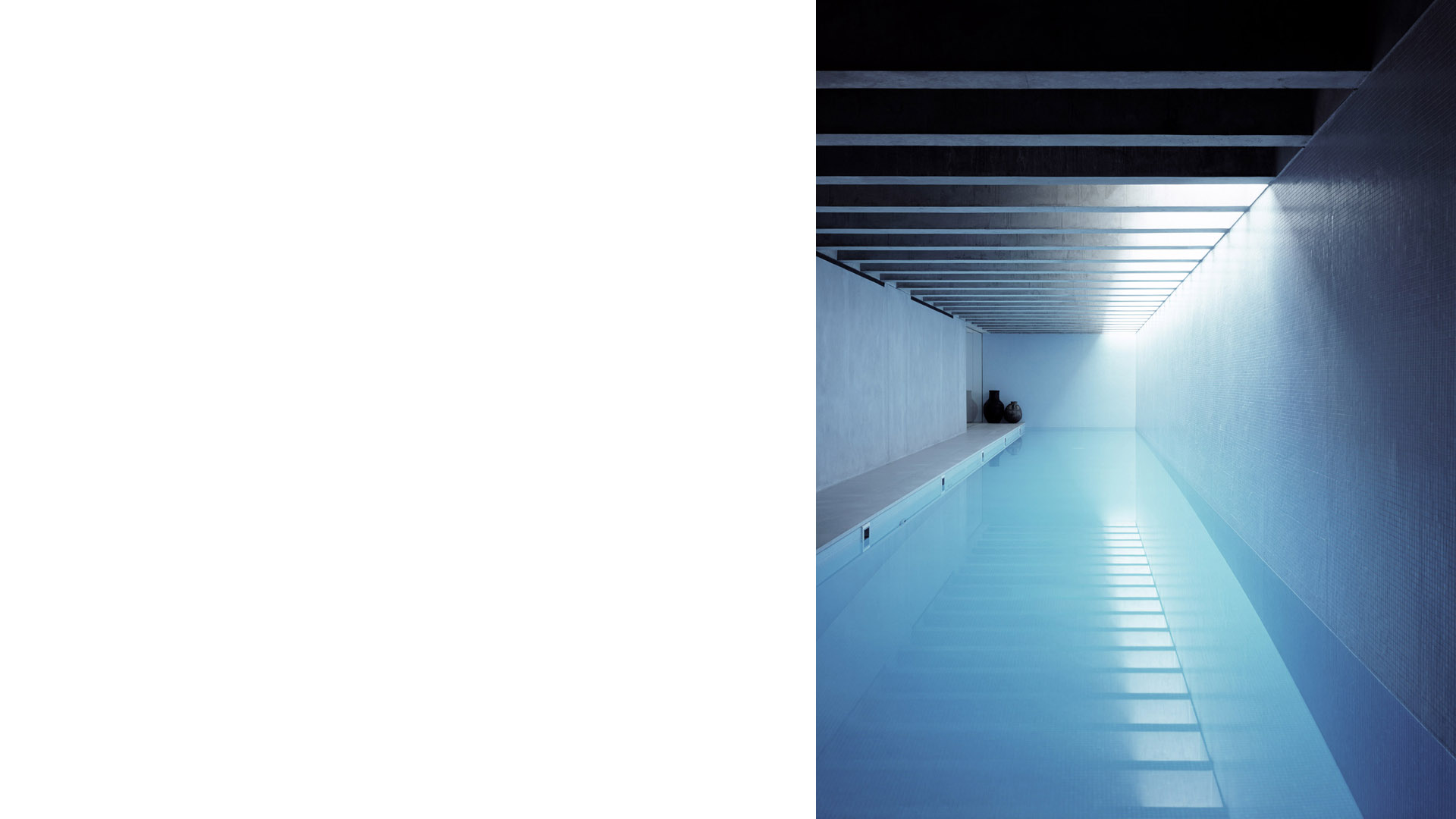 View of the subterranean toplit 20m swimming pool at the Long House. A multi-award winning contemporary house in London by Keith Williams Architects. Photograph Hélène Binet