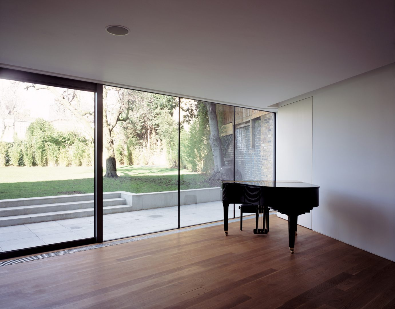 Main reception room at the Long House London. A multi-award winning contemporary house by Keith Williams Architects.