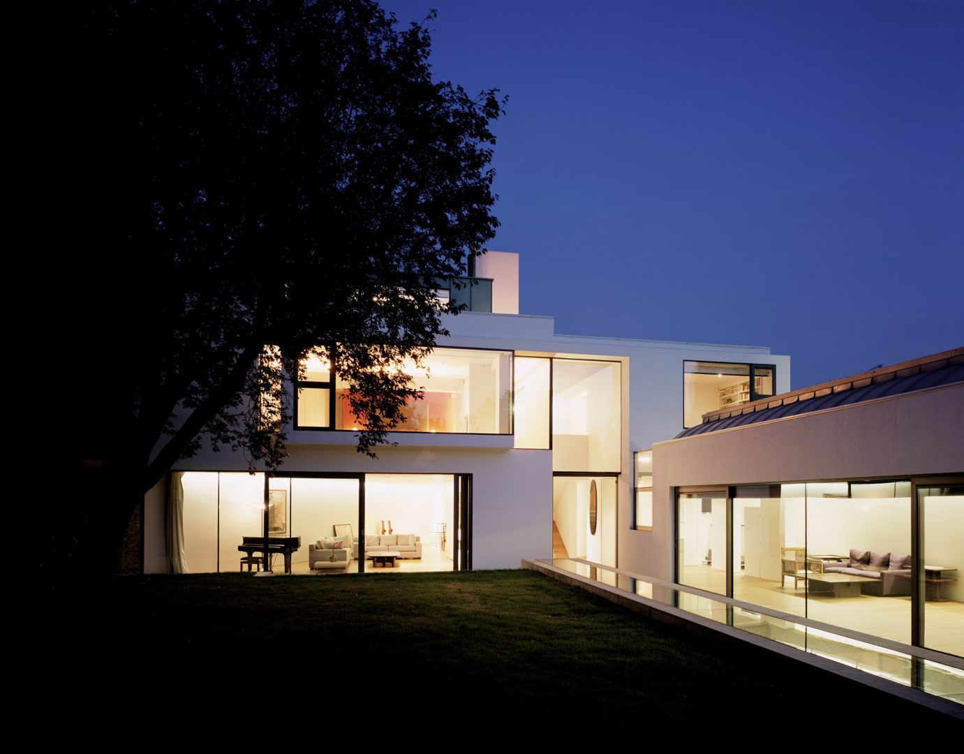 The Long House at dusk. A multi-award winning contemporary house in London