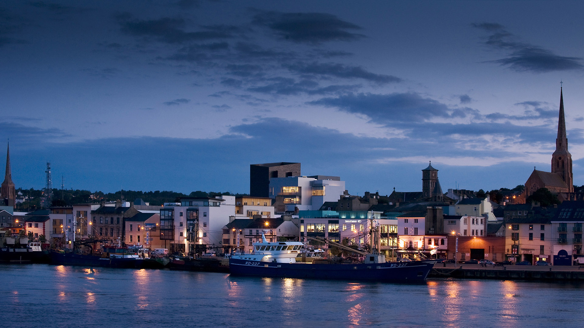 Night view of the National Opera House and waterfront viewed from across the River Slaney, Wexford Ireland. One of the great small opera houses of the world.
