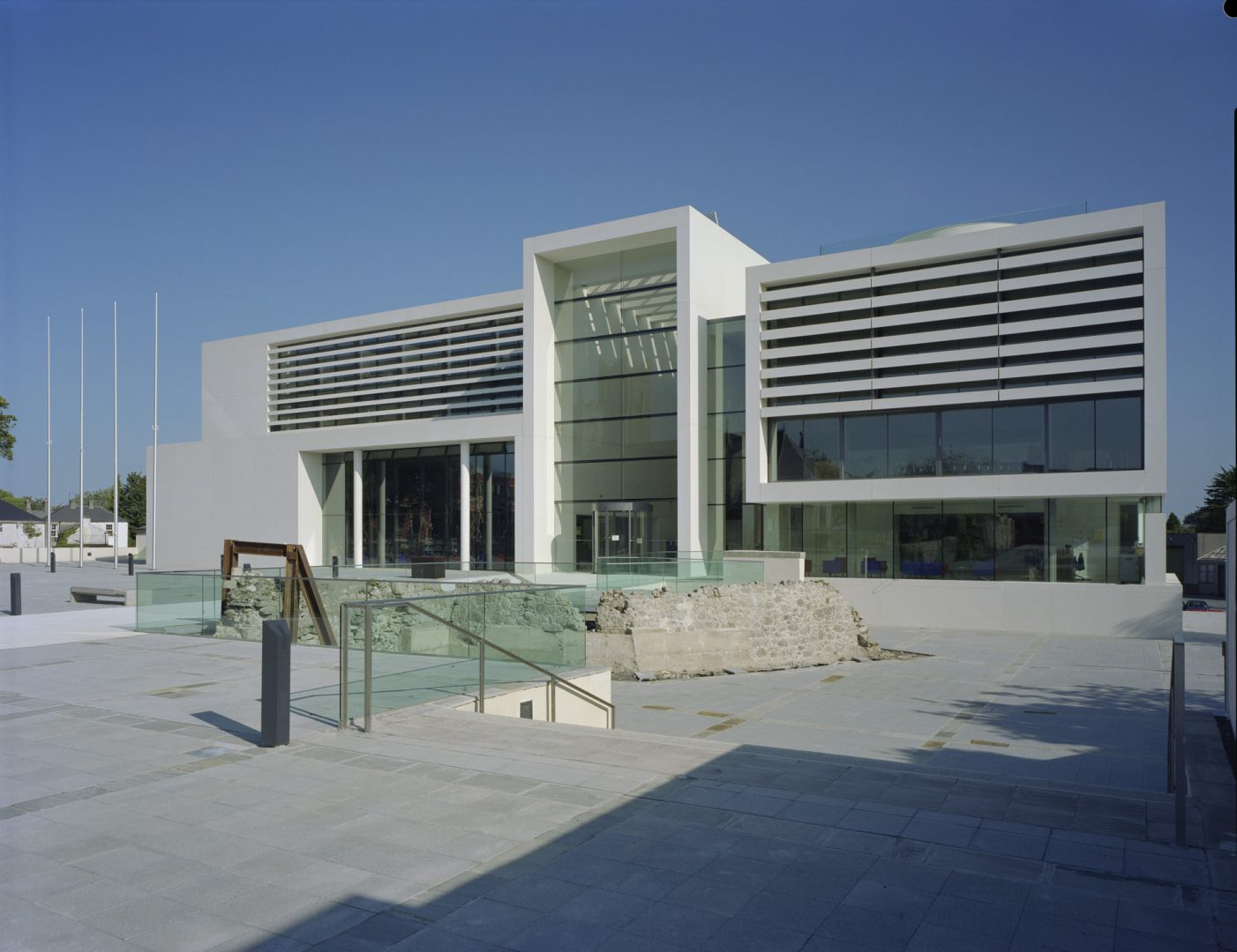 Main facade at Athlone Civic Centre seen across the new public square. The concrete ribs across the facade reject southern sun and are a key part of the building's sustainability strategy.
