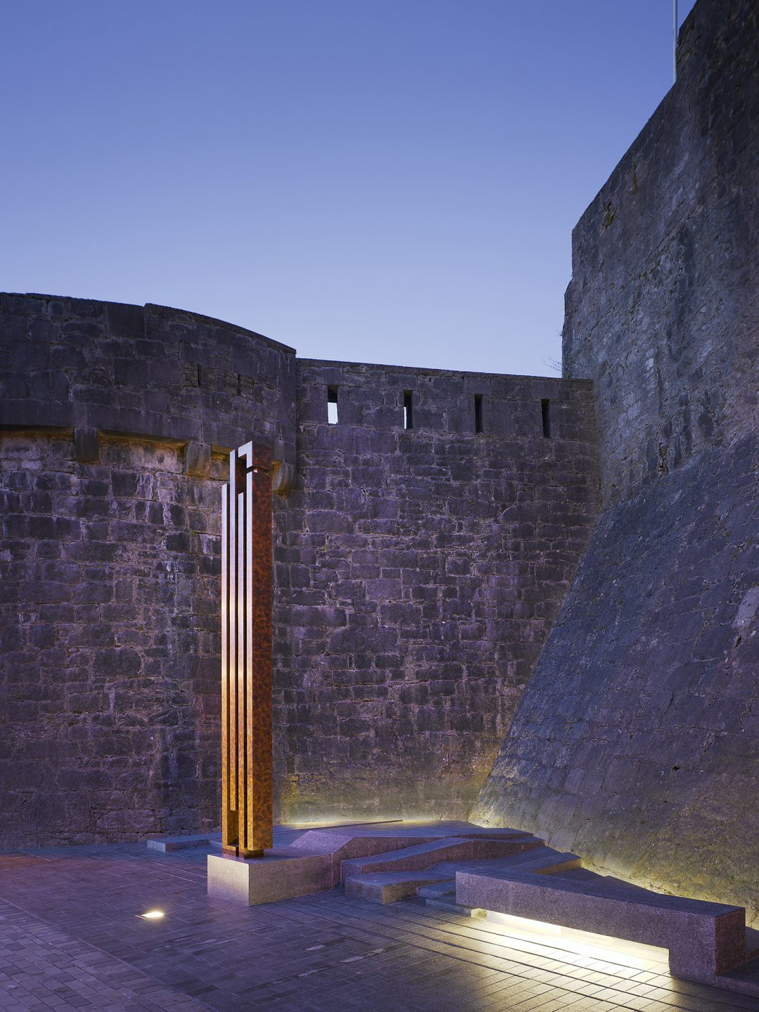 Bronze cenotaph and base at Athlone Army Memorial, Athlone Castle Ireland at dusk