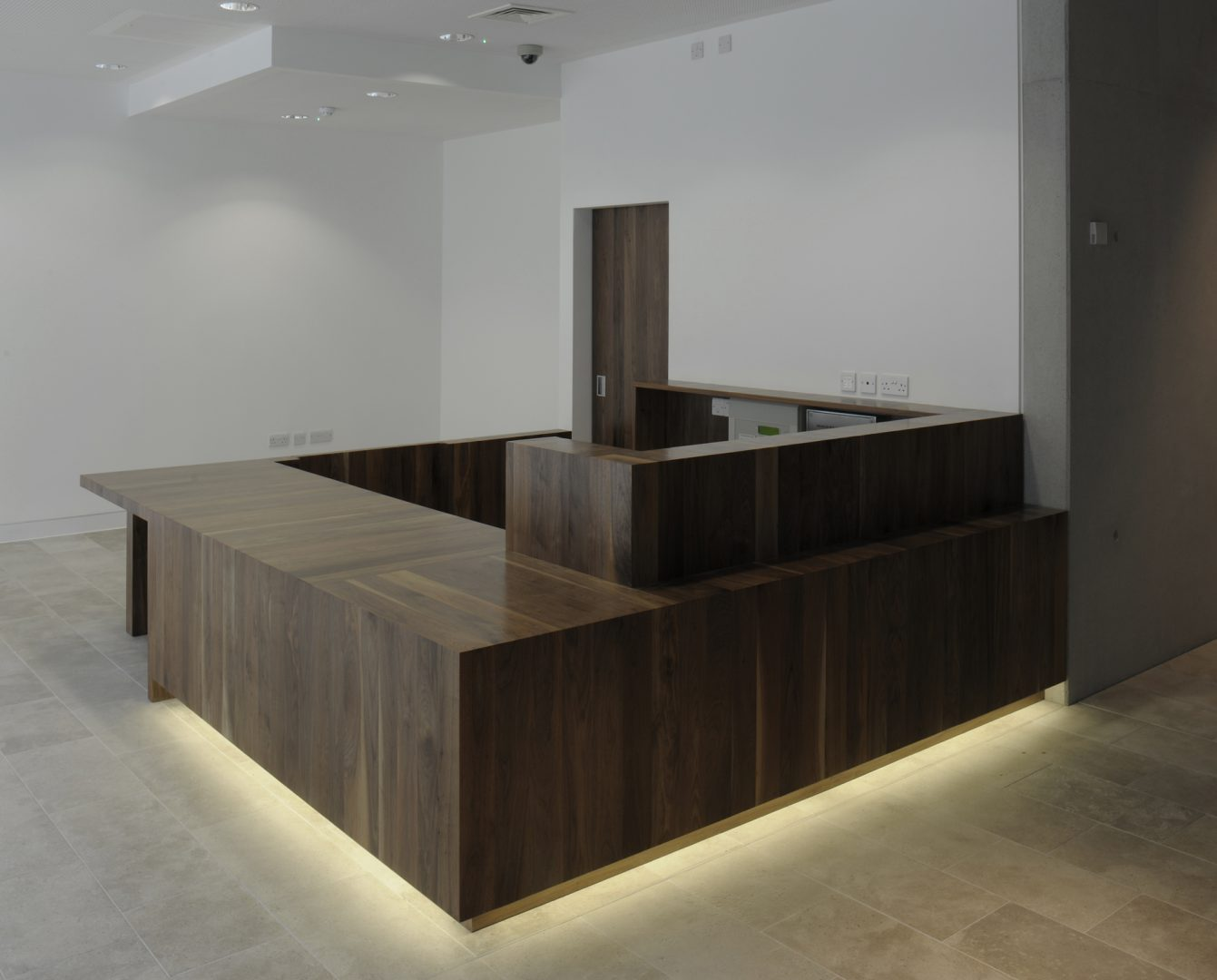 Interior detail of the Novium's main reception desk in Black American walnut