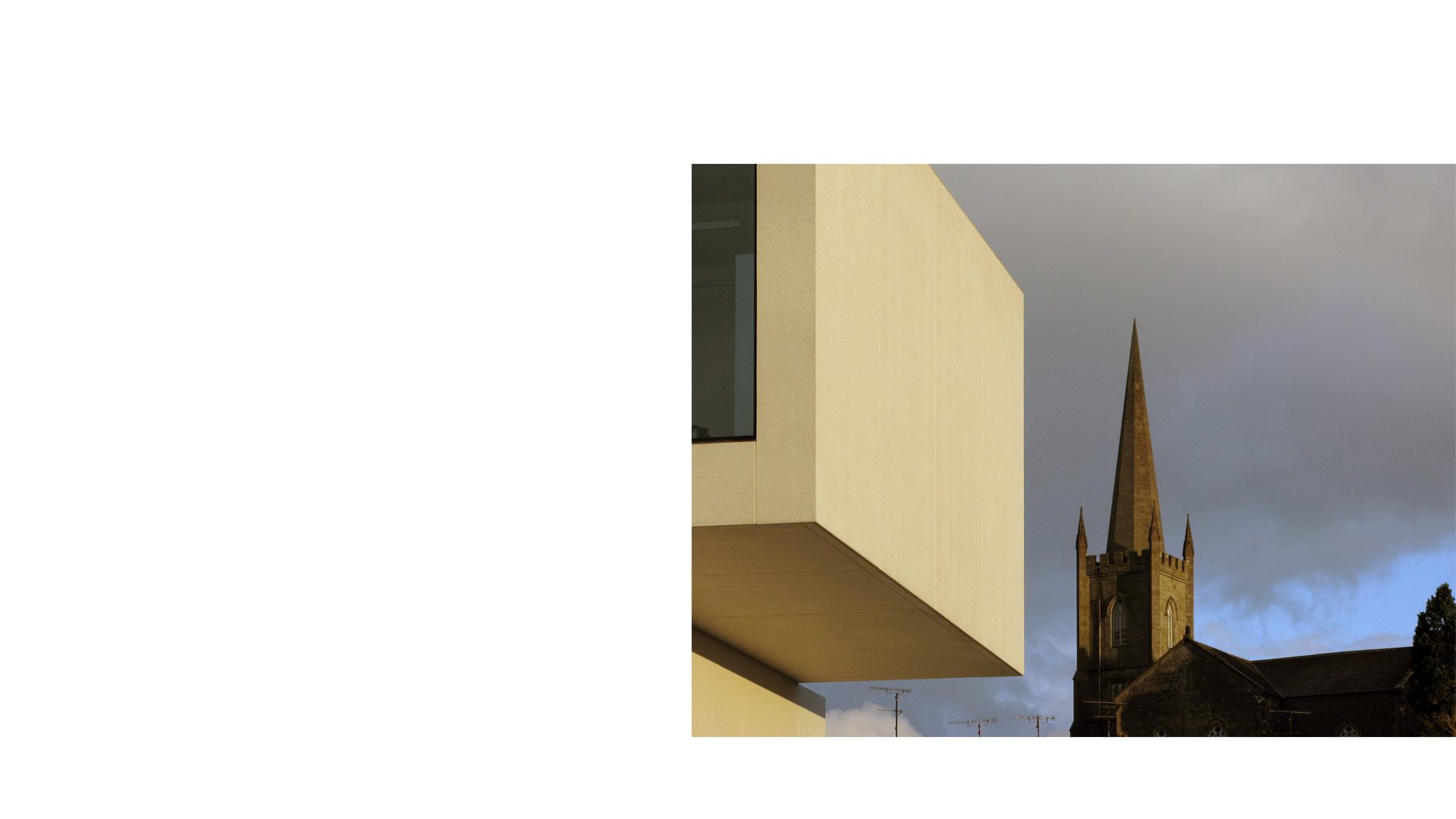 Clones Library and County Library HQ, detail against church spire
